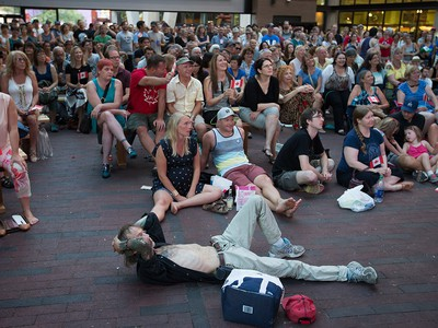 People gather during a viewing party for the final stop in Kingston, Ont., of a 10-city national concert tour by The Tragically Hip, in Vancouver, B.C., on Saturday August 20, 2016. Lead singer Gord Downie announced earlier this year that he was diagnosed with an incurable form of brain cancer. THE CANADIAN PRESS/Darryl Dyck ORG XMIT: VCRD113