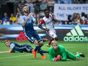 Vancouver Whitecaps' Tim Parker, back left, David Edgar and goalkeeper David Ousted, front right, react as San Jose Earthquakes' Simon Dawkins, back right, watches his shot enter the net for a goal during the second half of an MLS soccer game in Vancouver, B.C., on Friday August 12, 2016.