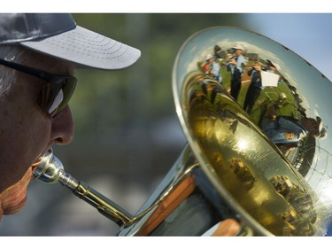 An ensemble  member of the Vancouver Fire and Rescue Services band plays at the Opening ceremonies for the Canadian Little League Championship