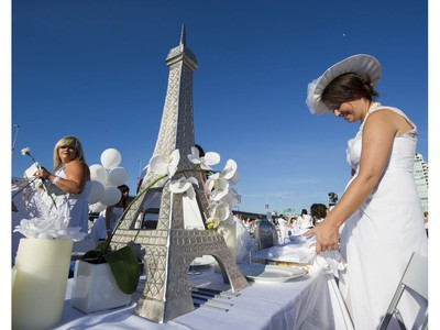 A model of the Eiffel tower adorns a table at Le Diner en Blanc at Concord Pacific Place Vancouver, August 18 2016.