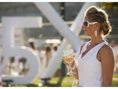 A woman at Le Diner en Blanc at Concord Pacific Place Vancouver, August 18 2016. ( Gerry Kahrmann  /  PNG staff photo)  ( Prov / Sun News ) 00044608A  [PNG Merlin Archive]