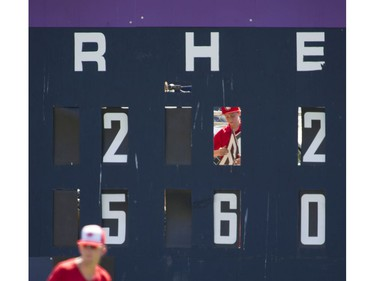 VANCOUVER August 19 2016. Henry Bull changes  the numbers for hits on the scoreboard for a Vancouver Canadians game at Nat Bailey stadium  Vancouver, August 19 2016. ( Gerry Kahrmann  /  PNG staff photo)  ( Prov / Sun News ) 00044657A Story by Steve \Ewen [PNG Merlin Archive]