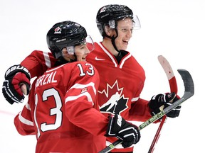 Canada's Mathew Barzal, left, celebrates his team's win over Switzerland with teammate Thomas Chabot at the IIHF World Junior Championship in Helsinki in December 2015. Does the Seattle Thunderbirds get centre Barzal, 19, back from the New York Islanders this season?