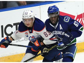 Vancouver Canucks' Jordan Subban (67) has his eye on the puck next to  Edmonton Oilers' Matt Benning (83) during first period 2016 NHL Young Stars Classic action at the South Okanagan Events Centre in Penticton, BC., September 16, 2016.