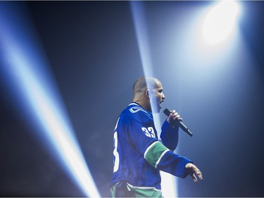 Drake performs on stage in a Vancouver Canucks jersey at Rogers Arena, Vancouver, September 17, 2016.