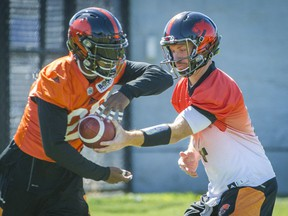 A former star quarterback himself, Travis Lulay, right, never complained about his limited but effective role with the B.C. Lions this year.