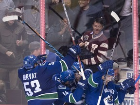 The Vancouver Canucks mob rookie defenceman Troy Stecher after he scored against the Dallas Stars with 1:40 left in the game to tie the score last week at Rogers Arena. Markus Granlund would go on to get the winner in a 5-4 overtime victory.