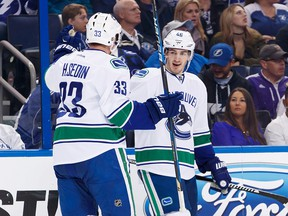 Jayson Megna of the Canucks celebrates one of his two goals with Henrik Sedin.