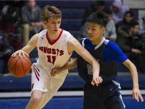 Lord Byng Grey Ghosts' Nathan Bromige drives the ball around Port Moody Blues' Stephen Feng Thursday at the Tsumura Basketball Invitational in Langley.
