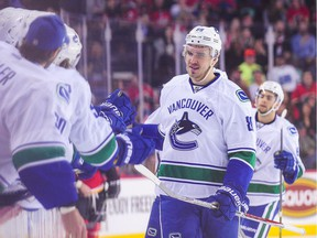Nikita Tryamkin #88 of the Vancouver Canucks celebrates with his teammates after scoring against the Calgary Flames during an NHL game at Scotiabank Saddledome on December 23, 2016 in Calgary, Alberta, Canada.