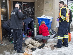 The Vancouver Fire Department medical unit responds to an unresponsive man in the Downtown Eastside in Vancouver.