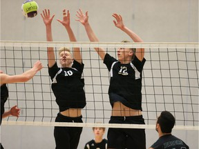 Walnut Grove's Brett Christensen, left, and Andrew Goertzen make an imposing wall at the net during Thursday's B.C. senior boys volleyball triple-A game against the Delta Pacers at the Langley Events Centre.