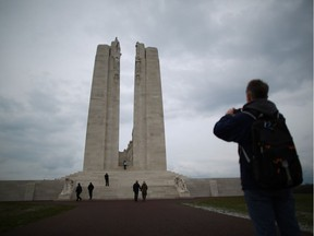 Visitors walk towards the Canadian National Vimy Memorial in France.