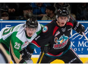 Forward Jordan Borstmayer, then with the Kelowna Rockets, battles for position with Sean Montgomery of the Prince Albert Raiders. Borstmayer, dealt to the Vancouver GIants, looks to add some depth and offence to the WHL squad.