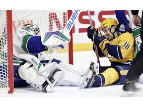 Viktor Arvidsson laughs after he and Canucks goalie Jacob Markstrom collide.