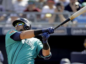 FILE - In this Feb. 26, 2017, file photo, Seattle Mariners' Nelson Cruz watches his solo home run during the second inning of a spring training baseball game against the San Diego Padres,in Peoria, Ariz. Going into the 45th season since the designated hitter was approved by MLB owners for the American League, more managers now seem willing to spread around the DH starts instead of penciling the same player in the lineup just about every day.
