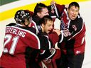 Vancouver Giants, left to right, Brett Festerling, golie Tyson Sexsmith, Michal Repik and Wacey Rabbit celebrate their 3-1 win over the Medicine Hat Tigers, to win the 2007 Memorial Cup final at the PNE Coliseum on Sunday afternoon.