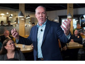 NDP Leader John Horgan speaks about details of the party's election platform after its release during a campaign stop at an Italian restaurant in Coquitlam, B.C., on Thursday April 13, 2017. A provincial election will be held on May 9.