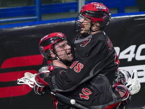 Vancouver Stealth teammates Rhys Duch  and Logan Schuss celebrate Duch's goal on the Colorado Mammoth Saturday at the Langley Events Centre.