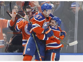 Edmonton Oilers' Connor McDavid (97) and Leon Draisaitl (29) celebrate a goal during overtime NHL action against the Anaheim Ducks, in Edmonton, Alta., on Saturday, April 1, 2017. THE CANADIAN PRESS/Jason Franson ORG XMIT: EDM112