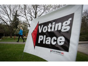 A woman arrives at a polling station to vote in the B.C. election in the Vancouver-Fraserview riding May 9.