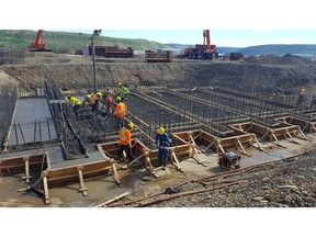 Workers pour concrete at the Site C construction project on the Peace River.