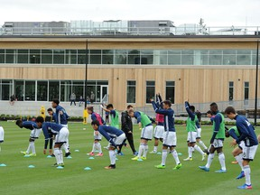 Players stretch outside the newly open Whitecaps FC National Soccer Development Centre (NSDC) at the University of British Columbia.