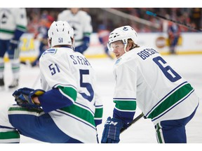 Troy Stecher, left, and Brock Boeser will be looking to make an impression, and the Vancouver Canucks' opening-night lineup this season.