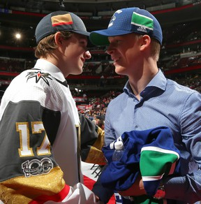 Elias Pettersson (right) is congratulated June 23 after being selected by the Vancouver Canucks in the first round of the NHL Entry Draft.