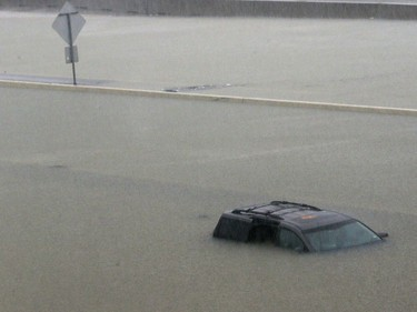An abandoned vehicle sits in flood waters on the I-10 highway in Houston, Texas, Sunday, Aug. 27, 2017.