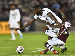 Vancouver Whitecaps' midfielder Tony Tchani fends off Colorado Rapids midfielder Michael Azira during Major League Soccer action at Dick's Sporting Goods Park on May 5.