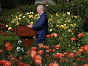 Premier John Horgan holds a press conference from the rose garden at Legislature following the speech from the throne last week.