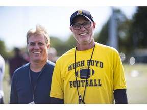 RICHMOND ,Bill (in Yellow) and Bruce (in Blue) Haddow are brothers who coach the Hugh Boyd football team. They're retiring from coaching this year after a combined 84 years of coaching football.,September 13 2017. , Richmond, September 13 2017. Reporter: ,  ( Francis Georgian  /  PNG staff photo)  ( Prov / Sun News ) 00050571A  [PNG Merlin Archive] Francis Georgian, PNG
