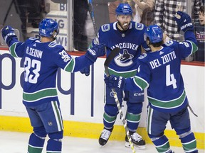 Sam Gagner is congratulated for his 3rd period goal and first as a Canuck.