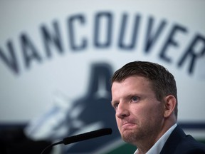 """Vancouver Canucks' forward Derek Dorsett, who decided to retire due to medical reasons, pauses while speaking during a news conference in Vancouver on Wednesday. """"I could sense (my family members) were worried. So (this retirement) was a relief for them. A relief for them, knowing I am going to be able to live a happy life."""""""