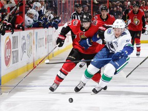 Troy Stecher of the Vancouver Canucks, beating Tom Pyatt of the Ottawa Senators to the puck in this battle, has proven that skill and quickness are great equalizers for players not blessed with size.