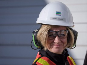 B.C. can expect more get-tough actions from Alberta, Premier Rachel Notley (seen touring a pipe, casing and tubing plant) tells The Province's Mike Smyth.