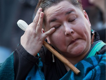 An Indigenous woman wipes away tears during a rally for Tina Fontaine in Vancouver, B.C., on Saturday February 24, 2018. A man accused of killing a 15-year-old Indigenous girl and dumping her body in Winnipeg's Red River was found not guilty of second-degree murder this week.Tina Fontaine's remains were discovered eight days after she was reported missing in August 2014.