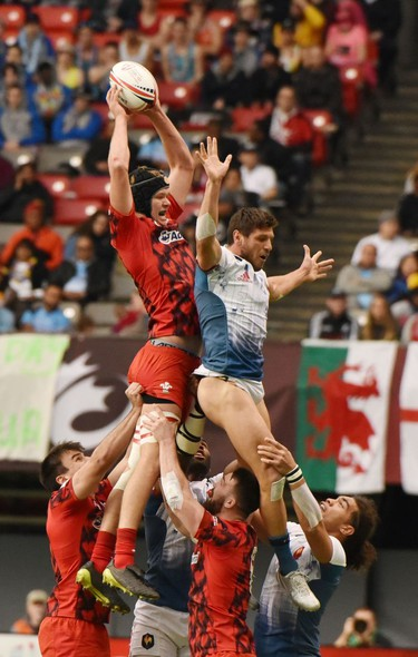 France 7's,(blue &white) and Wales (red)compete in HSBC Canada Men's Sevens action at BC Place Stadium in Vancouver, British Columbia on March 11, 2018. Vancouver is the 6th round, played March 10-11, 2018, in the HSBC Men's Sevens 10 round world series.