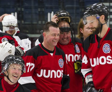 Musicians Barney Bentall, Aaron Pritchett and Matt Sobb laugh as they take to the ice with NHL players and Olympians for a Juno Cup practice at the Bill Copeland Sports Centre in Burnaby on March 22, 2018.