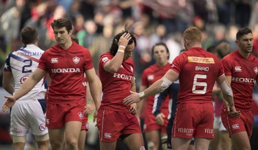 Team Canada reacts to loosing a match to the United States during the World Rugby Seven Series at B.C. Place in Vancouver, Saturday, March, 10, 2018.