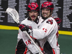 The Vancouver Stealth's Corey Small (right, celebrating a goal with teammate Logan Schuss earlier this season) is potentially the biggest trading chip the Stealth have as the league's trade deadline looms, but the cellar-dwelling club has indicated it's not interested in moving its leading scorer. (Photo: Gerry Kahrmann, PNG files)