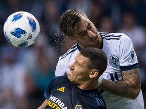 Vancouver Whitecaps' Jose Aja, back, and Los Angeles Galaxy's Daniel Steres fight for a ball during MLS action last month in Vancouver. Coach Carl Robinson says his squad needs to improve on set-piece plays and getting more aggressive in the offensive zone.