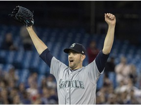 Seattle Mariners starting pitcher James Paxton, from Ladner, B.C., reacts after throwing a no hitter against the Toronto Blue Jays in American League MLB baseball action in Toronto on Tuesday May 8, 2018. Paxton is the first Canadian to have a no-hitter since Toronto's Dick Fowler did it for the Philadelphia Athletics in 1945.