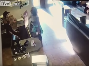 Screen shot of a video posted to Liveleak of an irate woman at a Tim Hortons in Langley.