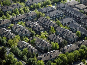 B.C. has joined jurisdictions throughout the world in limiting the real-estate purchasing power of foreign nationals. But a young woman's lawsuit claims the foreign-buyers tax is illegal. (Photo: A neighbourhood of townhouses in Richmond.)