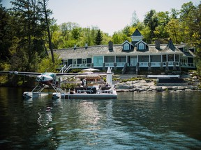 A float plane sits docked outside of a cottage in Ontario's Muskoka area. Prices of country retreats have jumped 13 per cent in the past year.