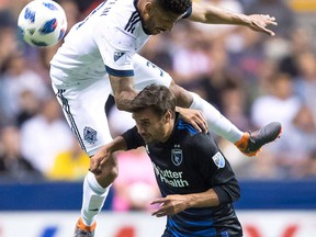 Vancouver Whitecaps' Sean Franklin, top, and San Jose Earthquakes' Chris Wondolowski vie for the ball during second half MLS soccer action in Vancouver on May 16, 2018. All friendships will be left on the sidelines this weekend when the Vancouver Whitecaps take the pitch in Washington, D.C.For Whitecaps defender Sean Franklin, Saturday's match will be somewhat of a homecoming. The 33-year-old played four seasons with D.C. United before signing with the Whitecaps in February.
