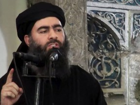 This image made from video posted on a militant website July 5, 2014, purports to show the leader of the Islamic State group, Abu Bakr al-Baghdadi, delivering a sermon at a mosque in Iraq during his first public appearance.
