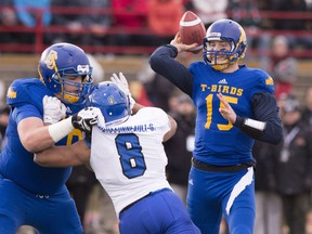 UBC Thunderbirds quarterback Michael O'Connor passes against the Montreal Carabins during first half football action at the Vanier Cup Saturday, November 28, 2015 in Quebec City. For Michael O'Connor, discussing his future is a distraction from his current goal, leading the University of B.C. Thunderbirds to another national championship.